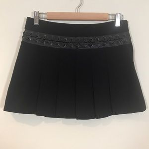 Bcbgmaxazria black pleaded mini skirt with leather